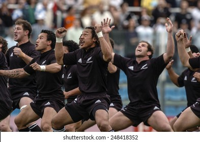 ROME, ITALY-NOVEMBER 13, 2004: new zealand rugby team players All Blacks performing the haka, maori traditional war dance, before the rugby test match Italy vs New Zealand, in Rome.