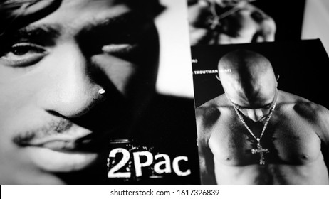 Rome, January 11, 2018: Collection of covers and cd inserts of the singer Tupac Shakur, considered by many to be one of the greatest hip hop artists of all time. selective focus