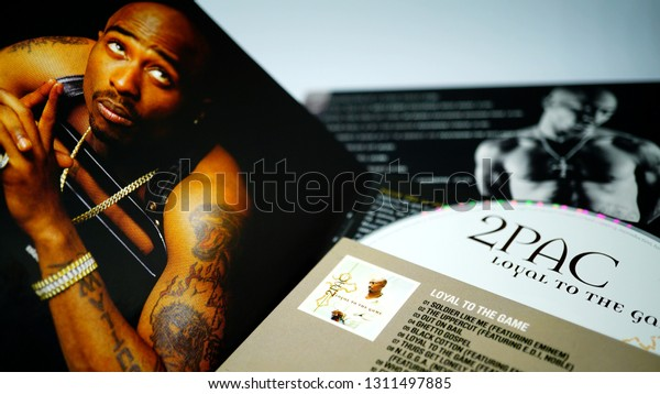 Rome, January 11, 2019: Collection of covers and cd inserts of the singer Tupac Shakur, considered by many to be one of the greatest hip hop artists of all time. selective focus