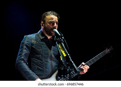 ROME - JUL 18: Chris Wolstenholme, bass guitar player of Muse (band), performs in concert at Rome stage on July 18, 2015 in Rome, Italy.