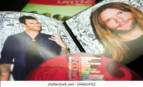 Rome, July 06, 2019: Detail of CDs and artwork of the American pop rock music group MAROON 5. With funk rhythms and typically soul melodies and guitars with dozens of singles in the charts