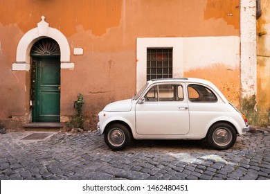 Rome - June 26, 2019. Vintage Fiat 500 parked in a cozy street in Trastevere, Rome, Italy, Europe. Trastevere is a romantic district of Rome, along the Tiber in Rome.
