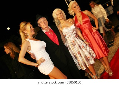 ROME - JUNE 3: Huge Heffner, the founder of Playboy, with his girls at the party of his 80th birthday - June 3, 2006 Rome, Italy