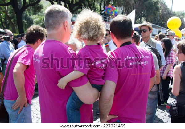 ROME - JUNE 7: Rome Gay Pride Parade on June 7, 2014 in Rome, Italy. A family of gay with the son.