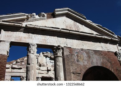 Rome, Lazio, Italy. February 2019: Frontal view of Portico d'Ottavia. Ancient structure. The colonnaded walks of the portico enclosed the temples of Jupiter Stator and Juno in Jewish Ghetto