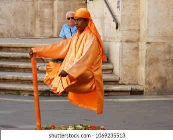 Rome, Lazio, Italy - May 30, 2017: Street Artist on Via del Corso, symbolizing an Indian santone suspended in mid-air