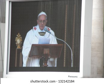 ROME - MARCH 19: Celebration of the beginning pontificate of Pope Francis in St. Peter's Square. Pope Francis on the big screen .   Italy, 19 March 2013, Rome, Vatican