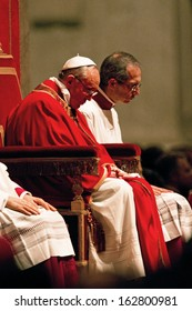 ROME - MARCH 2013: Pope Francis praying during an evening Good Friday service in St Peter's Basilica, two days before Easter - 29th March 2013