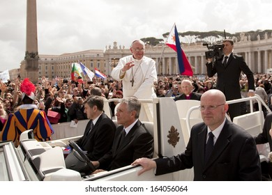 ROME - MARCH 2013: Pope Francis in a Popemobile on Easter Sunday, greeting the crowds in St Peter's Square, the Vatican, after Mass - 31st March 2013