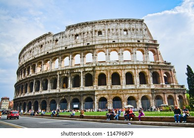 ROME - MARCH 25: Tourists visit the Colosseum on March 25, 2012 in Rome, Italy. According to Euromonitor's Destination Ranking, Rome is the 3rd most visited city in Europe
