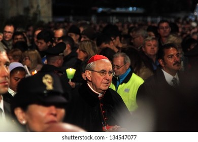 ROME - March 29: A cardinal walks through the crowd during the Stations of the Cross chaired by the Pope Francis I around the Colosseum on Good Friday on March 29, 2013 in Rome.