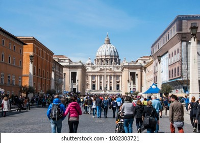 ROME - MARCH 30: people walking toward the St. Peter's church during the sunday Angelus on March 30, 2014 in Rome