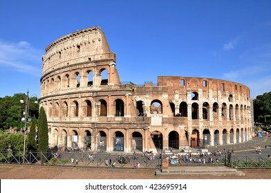 ROME - MAY 07: Tourists walking around Colosseum during the warm spring day on May 07. 2015 in Italy