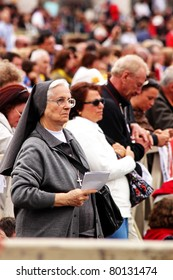 ROME - MAY 1 : unidentified elderly nun listens to the mass during the beatification of Pope John Paul II on may 1, 2011 in Rome