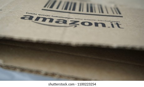 Rome, May 28, 2018: Amazon box detail with the Italian wording and the link to evaluate the packaging