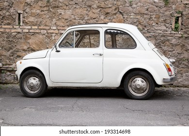 ROME - MAY 3, 2014 : Fiat 500 parked on May 3, 2014 in Rome. Fiat 500 was one of the most produced European cars ever with 3,893,294 units manufactured in years 1957-1975.
