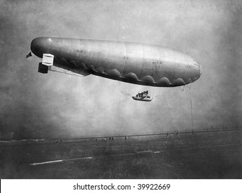 ROME - MAY 7 : Vintage photograph shows Italian airship 'M.51' with wooden cabin and three engines in flight at Ciampino Airport on May 7, 1918 in Rome, Italy.