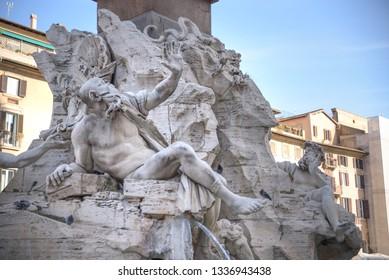 Rome, Navona square (Piazza Navona) church of St Agnese and fountain of the four rivers by Bernini. Statue depicting the Rio de la Plata river