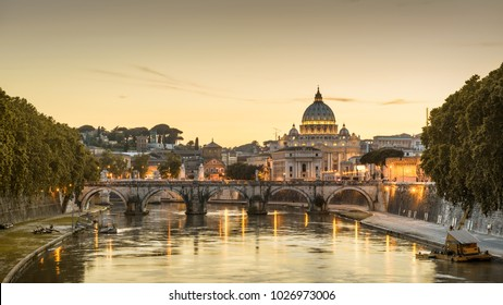 Rome at night, Italy. Sant`Angelo bridge and St Peter's Basilica. Rome landmark. Saint Peter's Basilica (San Pietro) is one of main travel attractions of Rome. Panoramic scenic view of night Rome.