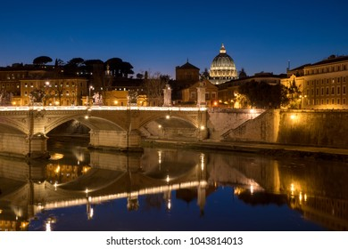Rome at night with St. Peter Basilica in Vatican visible