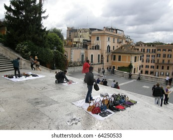 ROME -NOV 2: illegal sellers of fake bags work on the steps of Piazza di Spagna in Rome. November 2, 2010 in Rome, Italy