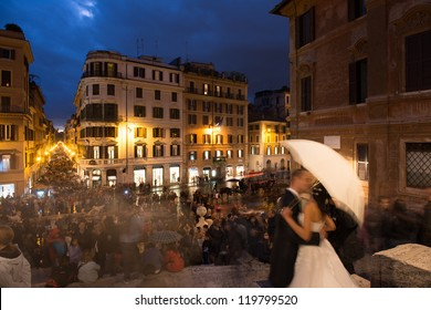 ROME - NOV 3: Newlyweds enjoy the view of Spanish Steps full of tourists at sunset, November 3, 2012 in Rome. More than 5 million people visit the city each year.