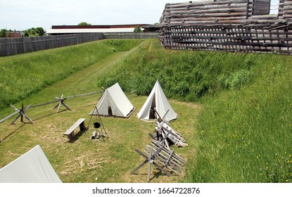 Rome, NY/USA - June 8, 2014: Fort Stanwix, the current fort is a reconstruction of the historic 18th century Fort, re-enactment tent camp in the moat