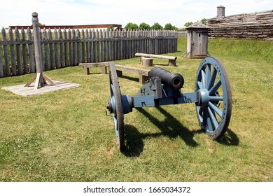 Rome, NY/USA - June 8, 2014: Fort Stanwix, the current fort is a reconstruction of the historic 18th century Fort, old cannon, wooden pillory and guard shack