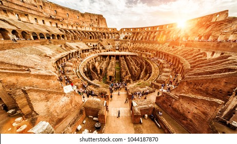 Rome - Oct 1, 2012: Inside the Ancient Colosseum or Coliseum in summer, Italy. Colosseum is main travel attraction of Roma. Tourists visit the Colosseum. Panoramic view of Colosseum in the sunlight.
