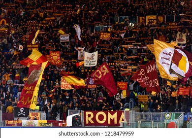 ROME - OCT 23, 2018: Ultras supporters of AS Roma with flags at the Stadio Olimpico before the UEFA Champions league match