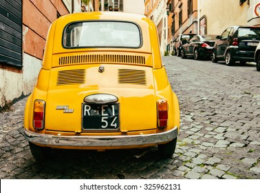 ROME - OCTOBER 20: Yellow Fiat 500 parked on October 20, 2013 in Rome. Italy