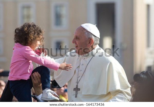 ROME - OCTOBER 2013: Pope Francis on audience, greeting the crowds in St Peter's Square, the Vatican, 30th October 2013.