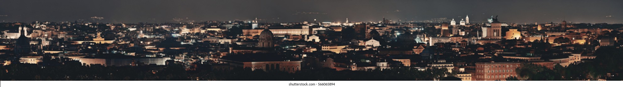 Rome rooftop panorama view with skyline and ancient architecture in Italy at night.