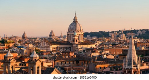 Rome rooftop view with ancient architecture in Italy at sunset moment.