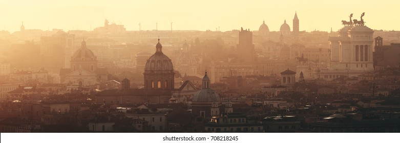 Rome rooftop view at sunrise silhouette panorama with ancient architecture in Italy.