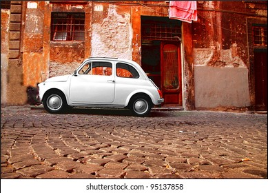 ROME - SEPTEMBER 13: A Fiat 500 on September 13, 2011 in Rome. Launched as the Nuova (new) 500 in July 1957, it was marketed as a cheap and practical town car. It soon become an Italian symbol.