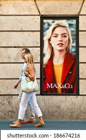 ROME - SEPTEMBER 18: unidentified couple walking past Max & Co. store ad at Via dei Condotti in Rome, Italy on September 18, 2013. Member of Max Mara launched in 1986 as the trendy youth division.