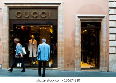 ROME - SEPTEMBER 18: unidentified man looking at Gucci show window at Via dei Condotti in Rome, Italy on September 18, 2013. As per Forbes 2013 list Gucci was ranked 38 most valuable brand.