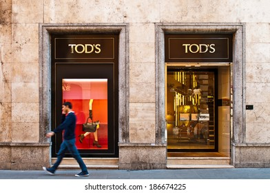 ROME - SEPTEMBER 18: unidentified man walking past Tod's at Via dei Condotti in Rome, Italy on September 18, 2013. Italian brand produces luxury shoes and leather goods with stores around the world.