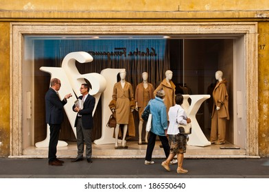 ROME - SEPTEMBER 18: unidentified men talking and women looking at Max Mara show window at Via dei Condotti in Rome, Italy on September 18, 2013. MaxMara had 2,254 stores in 90 countries by March 2008