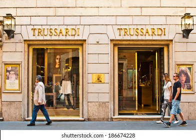 ROME - SEPTEMBER 18: unidentified people walking and looking at Trussardi store at Via dei Condotti in Rome, Italy on September 18, 2013. It is a luxury fashion brand made in Italy with +400 stores.