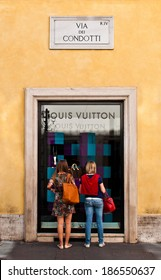 ROME - SEPTEMBER 18: unidentified women looking at Louis Vuitton show window at Via dei Condotti in Rome, Italy on September 18, 2013. It has been named the world's most valuable luxury brand.