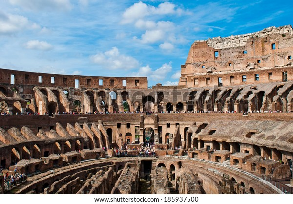 ROME - SEPTEMBER 19: interior view of the ancient Colosseum in Rome, Italy on September 19, 2013. It is one of Rome's most popular tourist attractions with over 5 million visitors per year.