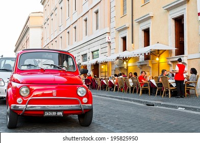 ROME - SEPTEMBER 21: vintage Fiat 500 parked next to a restaurant esplanade in Via della Conciliazione on September 21, 2013 in Rome, Italy. The world famous Italian automobile brand founded in 1899.