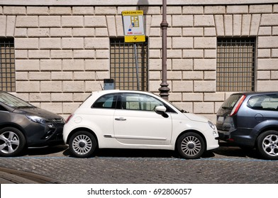 ROME - SEPTEMBER 8, 2013: Cars are parked on the street very tightly to each other. A common way of parking in large European cities.
