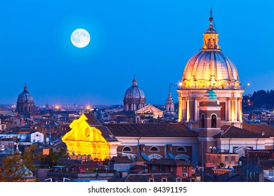 Rome Skyline at night. In the foreground San Carlo al Corso Church.