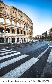 Rome Street in Italy and the Colosseum. Sunrise.