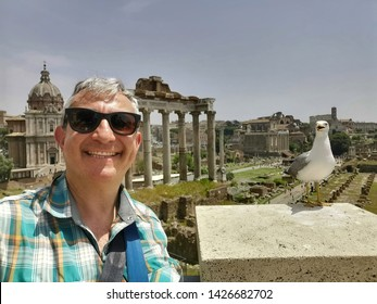 Rome tourist selfie with seagull at Imperial Forums on sunny day