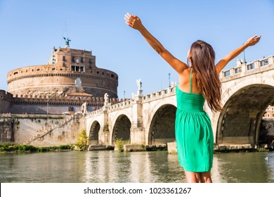 Rome travel tourist girl happy with arms up in freedom at Castel Sant'Angelo, popular attraction. Happy woman sightseeing at roman castle of Angels enjoying summer holidays travel in Italy, Europe.