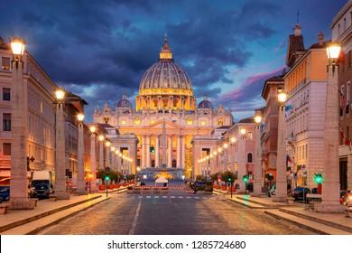 Rome, Vatican City. Cityscape image of illuminated Saint Peter`s Basilica and Street Via della Conciliazione, Vatican City, Rome, Italy.
